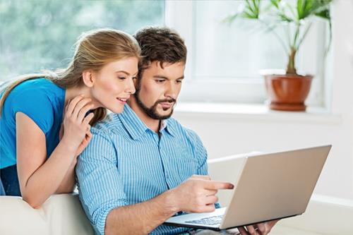 couple-laptop-106.jpg - Real Estate News