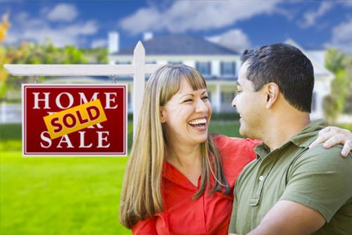 happy-couple-in-front-of-sold-home-123.jpg - Real Estate News